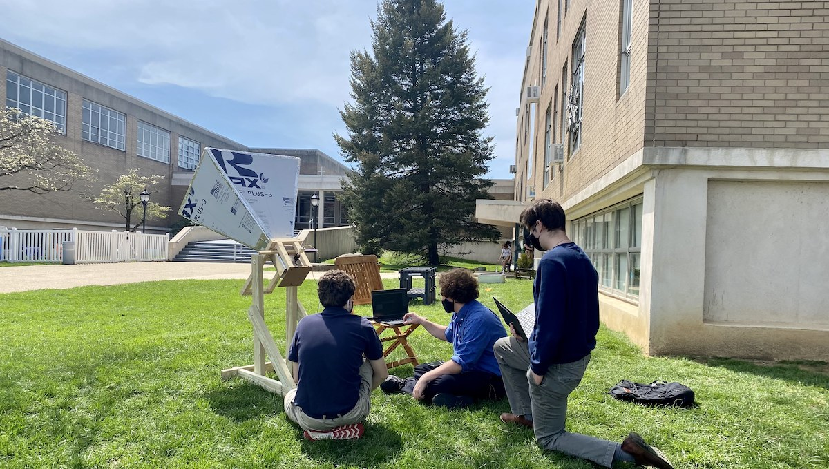 Grayson students positioning the radio telescope they built.